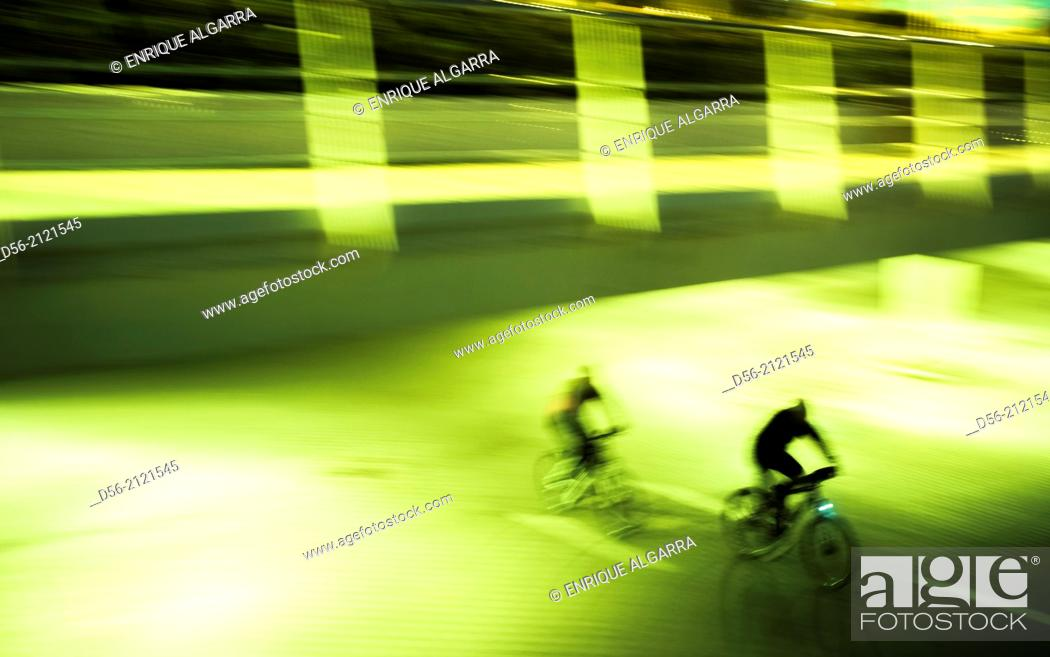 Stock Photo: Bikers at night, Old river bed Turia, Valencia, Spain.