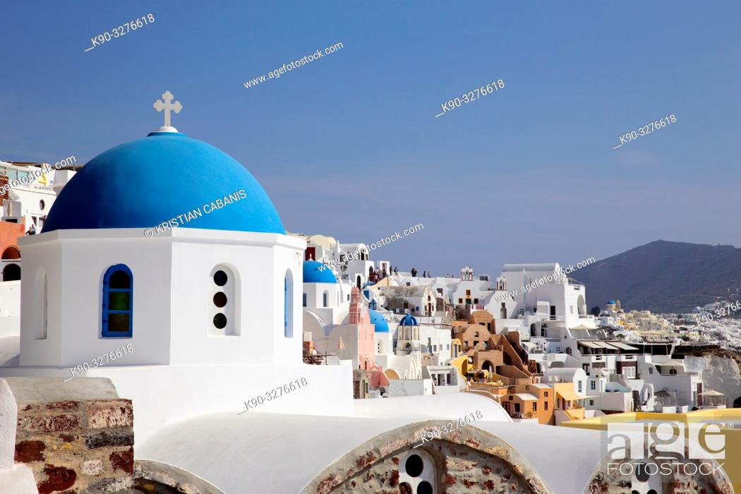Stock Photo: Church with blue roof top and houses in Oia, Santorin, Greece, Europe.
