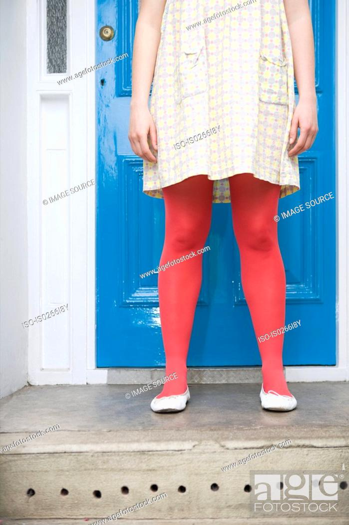 Stock Photo: Woman in tights standing on doorstep.