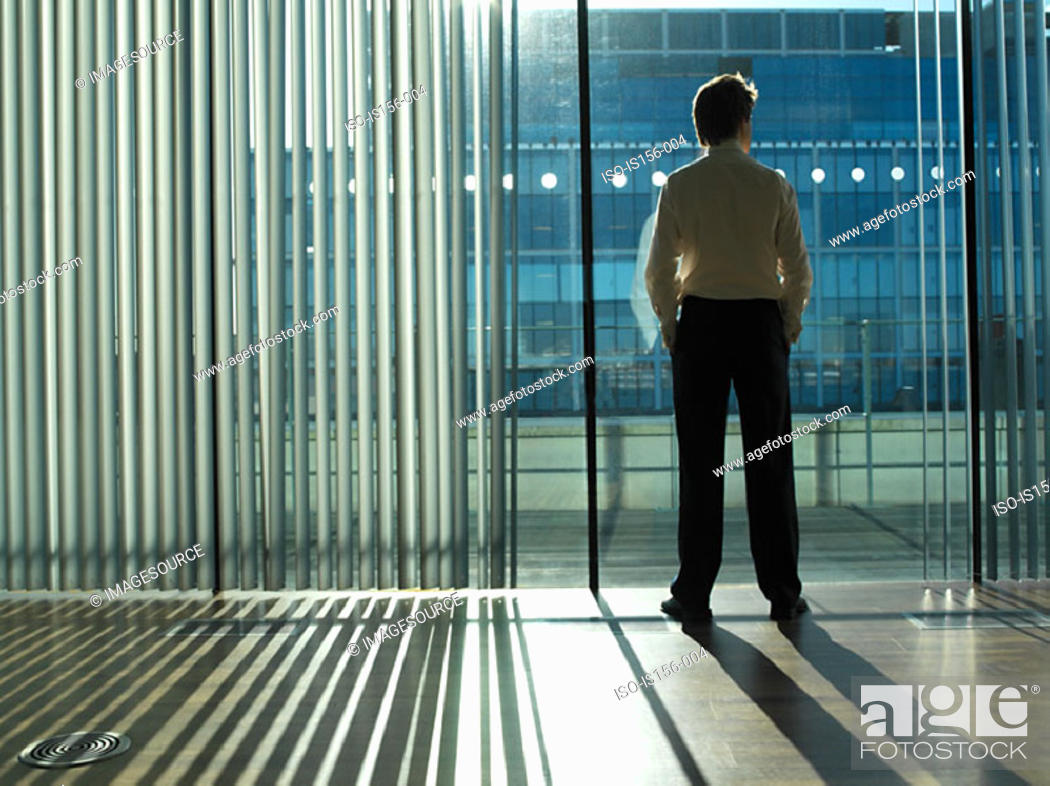 Stock Photo: Office worker looking out of the window.