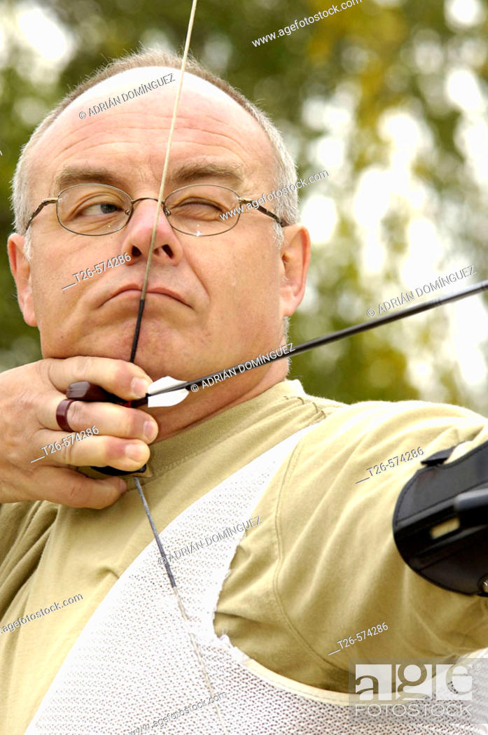 Stock Photo: Archery man sighting before the shot.