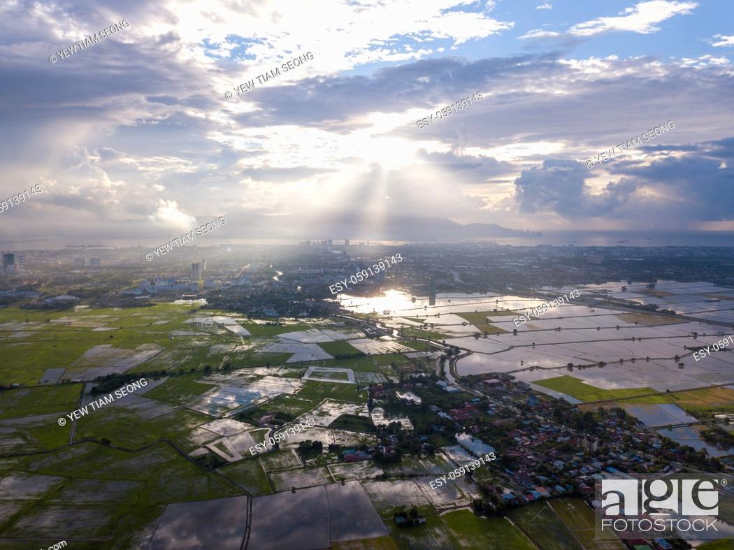 Stock Photo: Aerial view magnificent sun ray over paddy field at Perai, Penang.