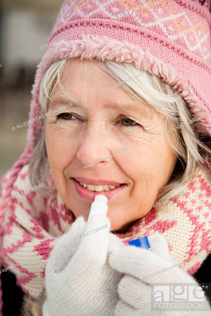 Stock Photo: Elderly person with lipstick in winter.