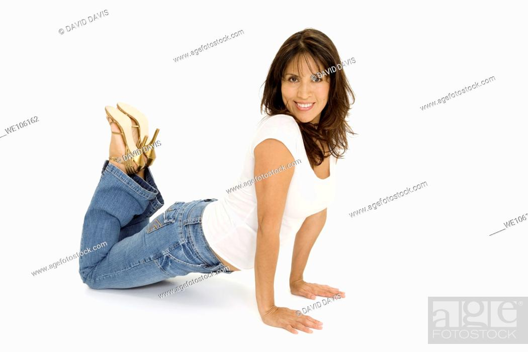 Stock Photo: Beautiful Brazilian or Hispanic woman in casual clothes on a white background.