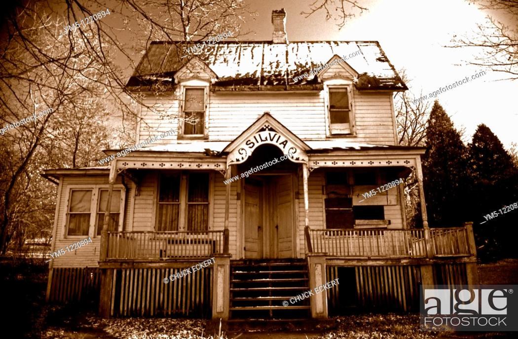 Stock Photo: Silvia's Old Haunted House in sepia tone.