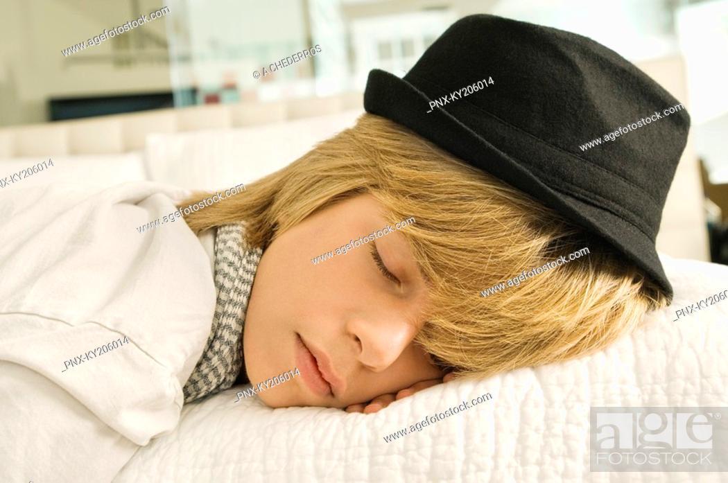 Stock Photo: Teenage boy sleeping on the bed.