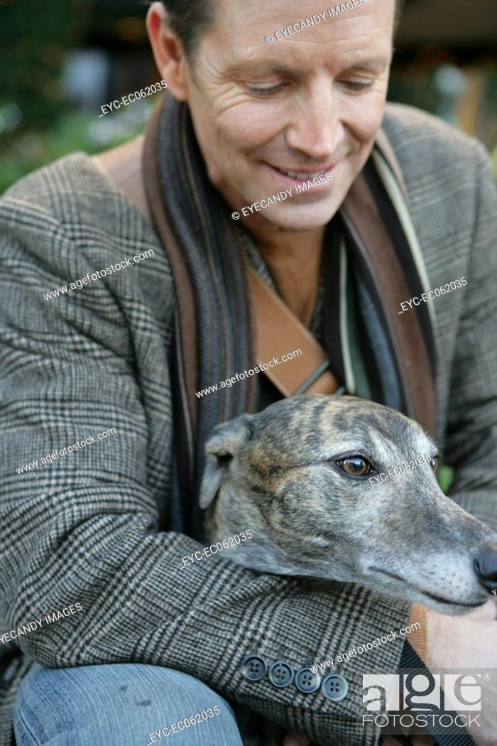 Stock Photo: Mature man with a Whippet.