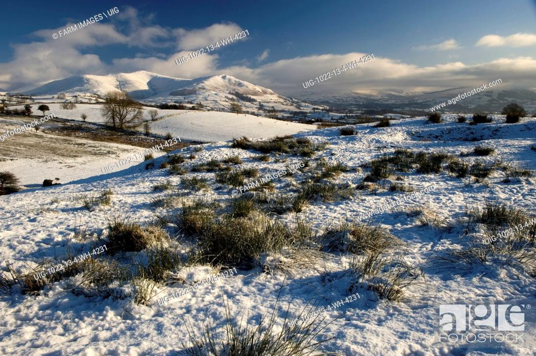 Stock Photo: Looking across snowcovered Howgill fells towards Sedbergh with Garsdale and Dent in the distance. Cumbria - England. (Photo by: Wayne Hutchinson/Farm.