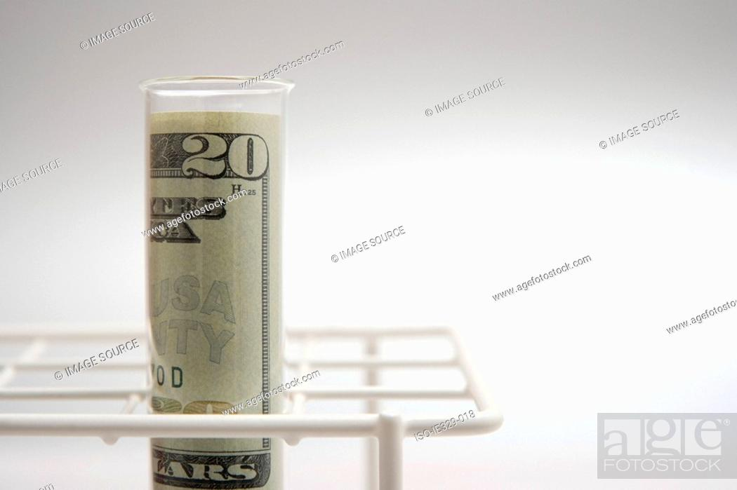 Stock Photo: American banknote in a test tube.
