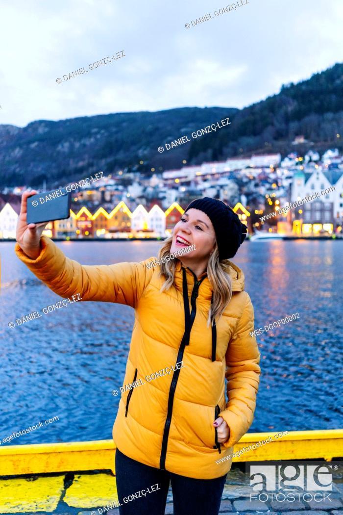 Stock Photo: Woman taking a selfie, Bergen, Norway.