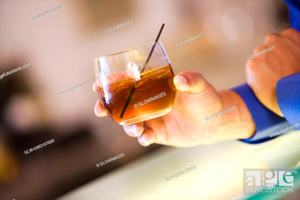 Stock Photo: Close-up of a man's hand holding a glass of wine.