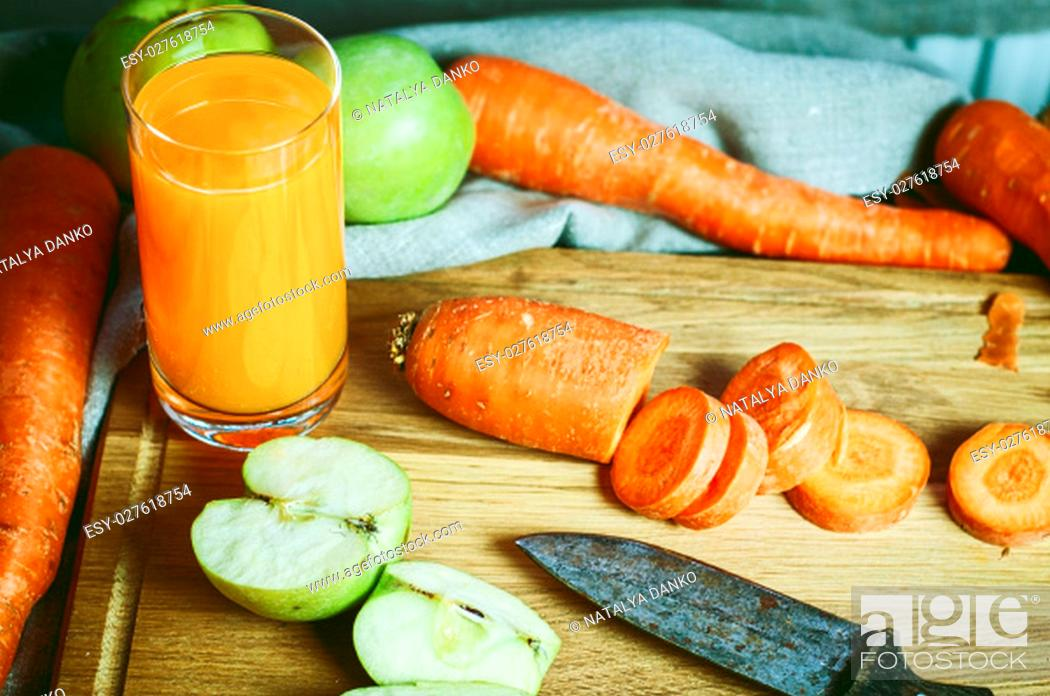Stock Photo: glass of fresh juice of carrots and apples with fresh vegetables and fruits, vintage toning.