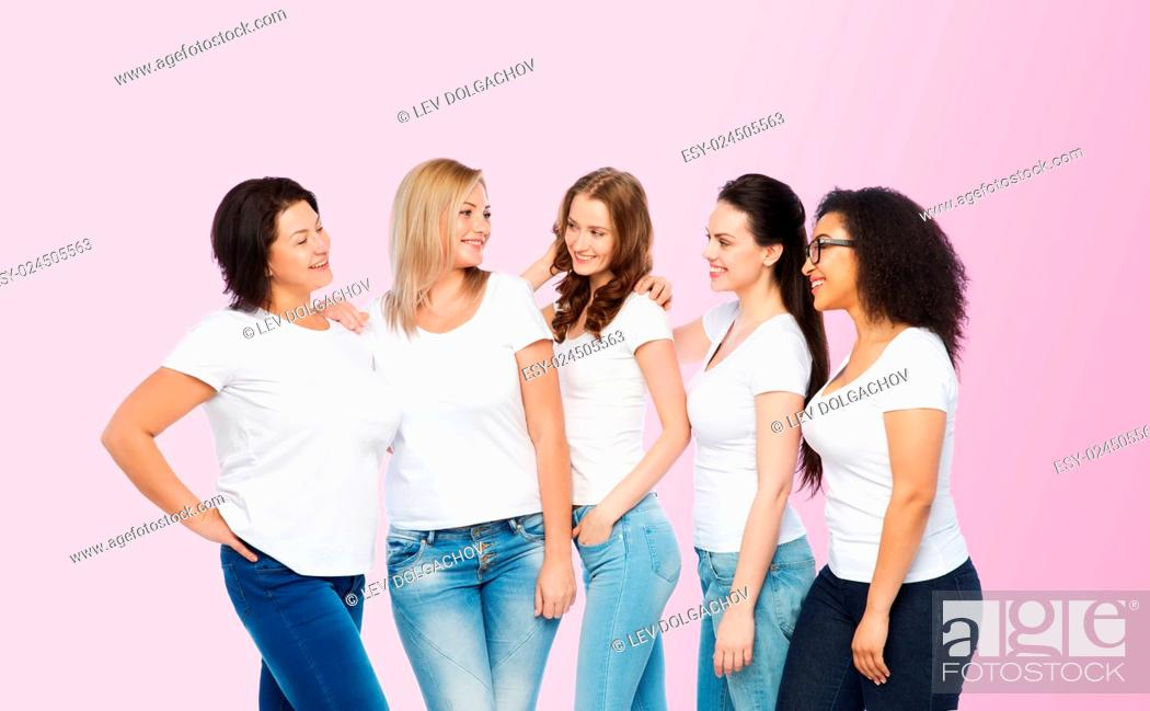 Stock Photo: friendship, diverse, body positive and people concept - group of happy different size women in white t-shirts hugging over pink background.