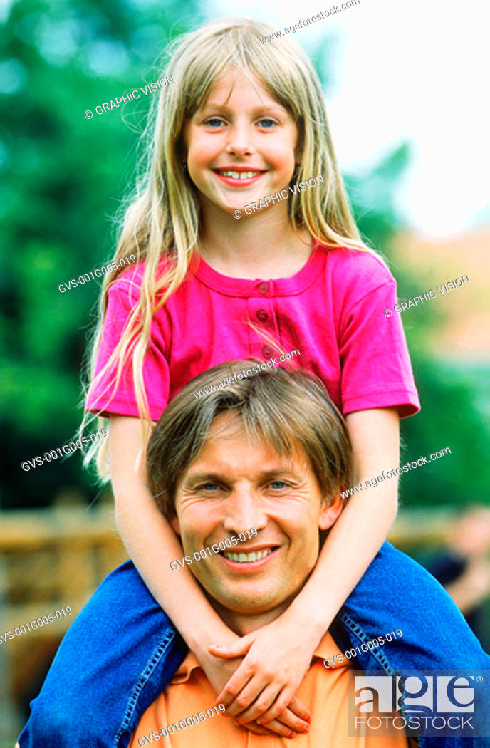 Stock Photo: Portrait of a father carrying his daughter on his shoulder.
