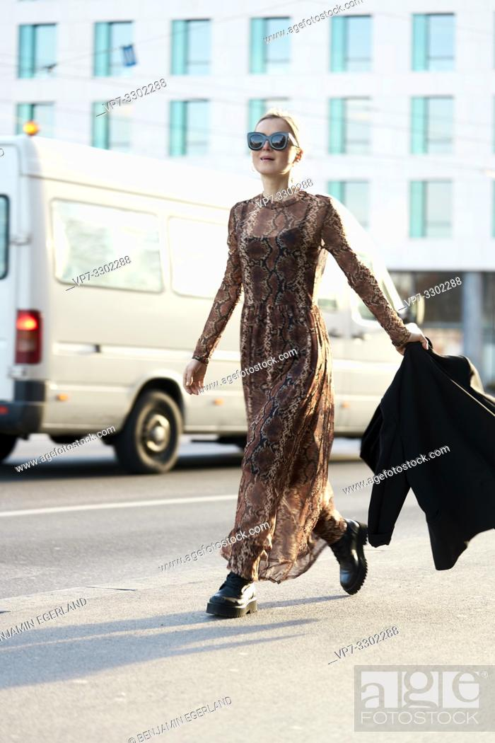 Stock Photo: fashionable woman walking at street in city, in Munich, Germany.