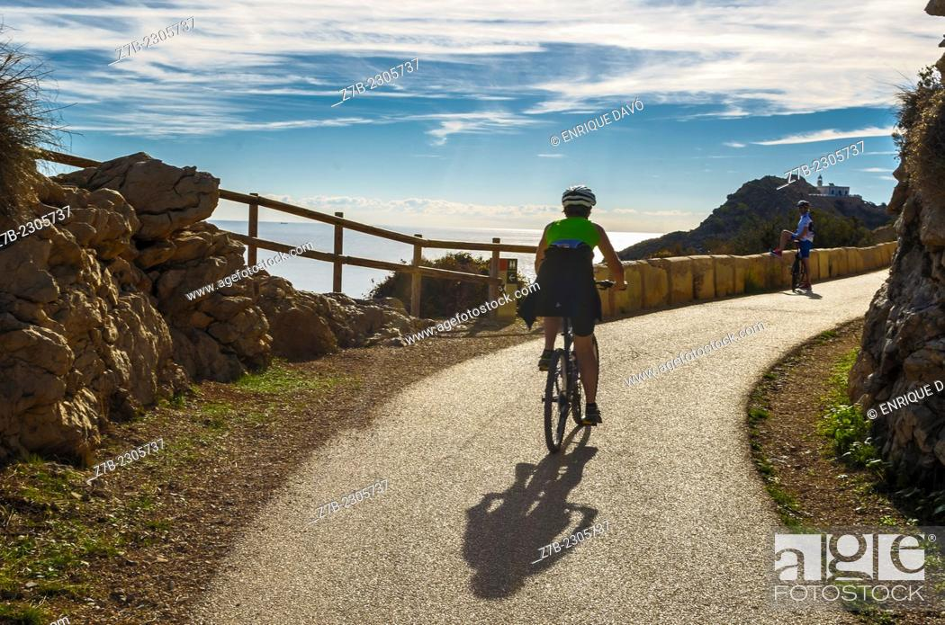 Stock Photo: Down view of a cyclist closed to the Albir lighthouse, Alicante north, Spain.