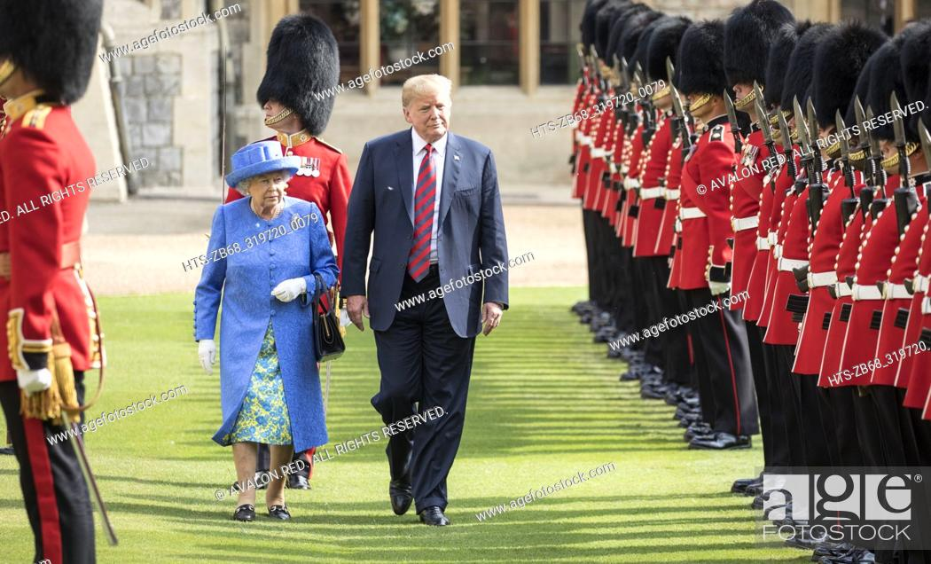 Stock Photo: The Queen walks with President Trump as they inspect the Coldstream guards at Windsor castle.