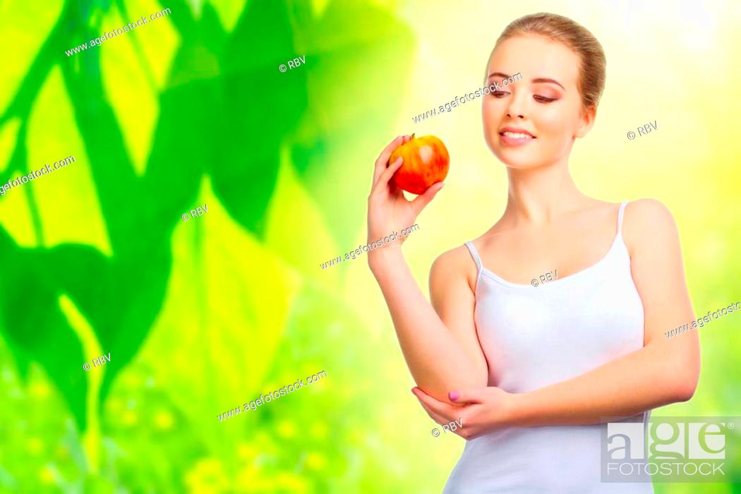 Stock Photo: Young healthy woman on spring background.