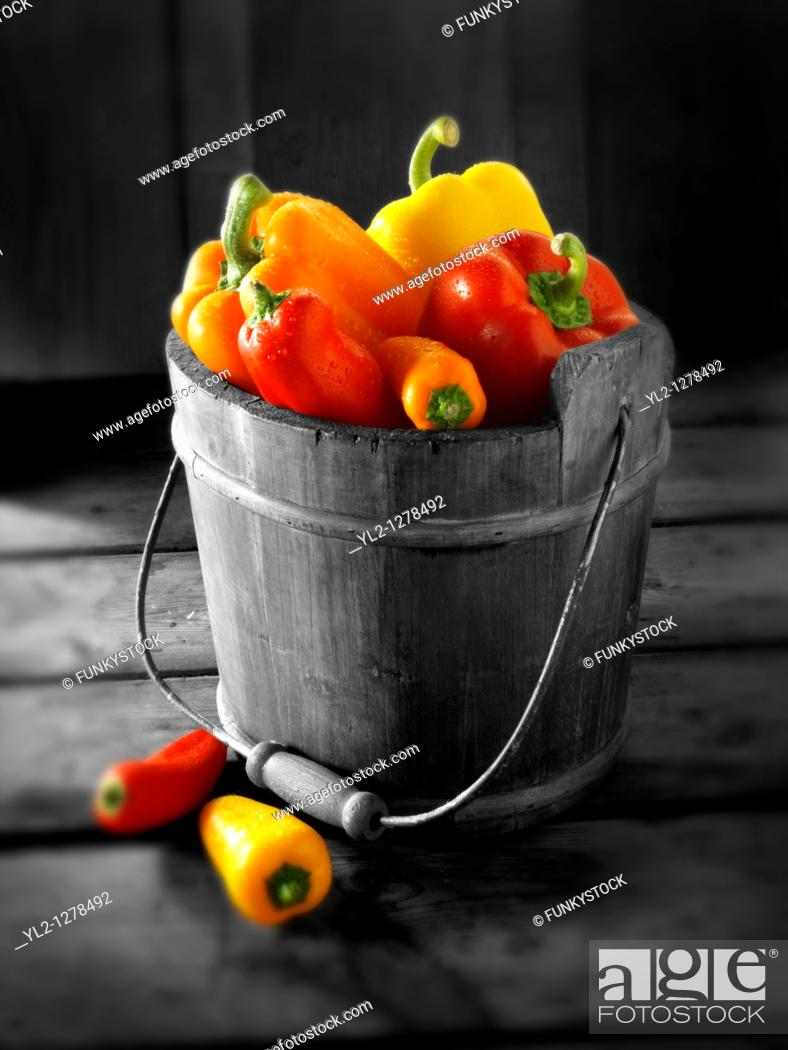 Stock Photo: Mixed red, yellow & orange fresh bell peppers.