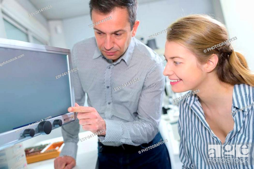 Stock Photo: businessmwoan showing something on computer.