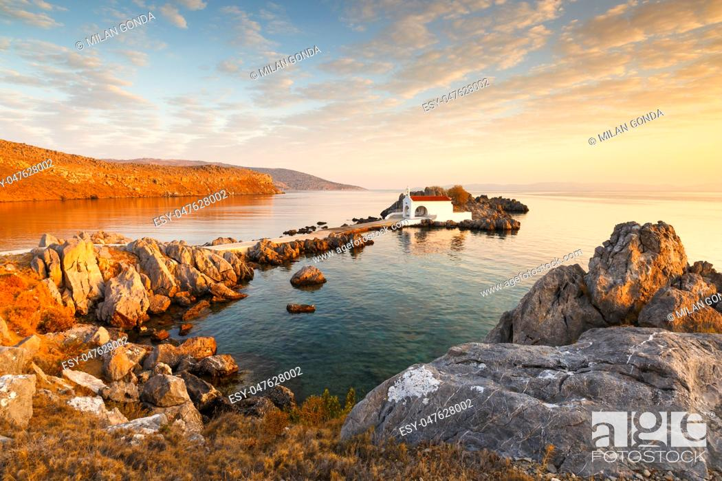 Stock Photo: Agios Isidoros church in northern Chios at sunrise. .