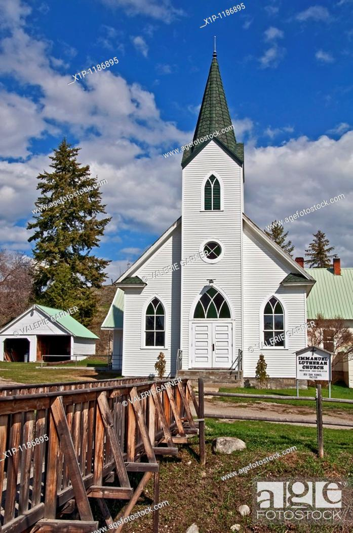 Stock Photo: This white classic turn of the century church was built in 1917 and is located in Havillah Washington in Okanogan County It's shot during the day with bright.