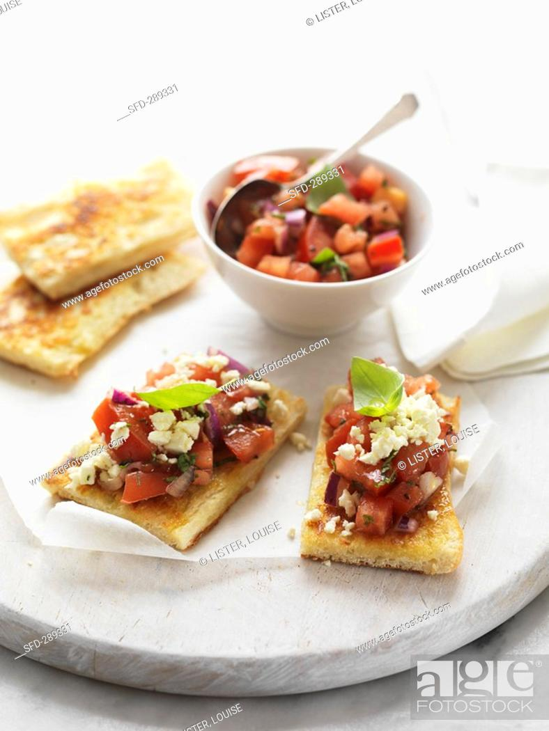 Stock Photo: Flatbread topped with tomato salsa and feta.