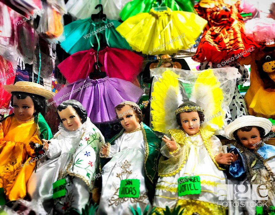 Stock Photo: Sculptures of Baby Jesus decorate a market in Oaxaca, Mexico.