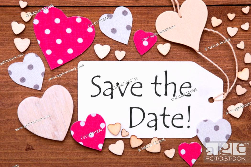 Stock Photo: One Label With English Text Save The Date. Flat Lay View With Wooden Vintage Background. Pink Wooden And Paper Hearts.