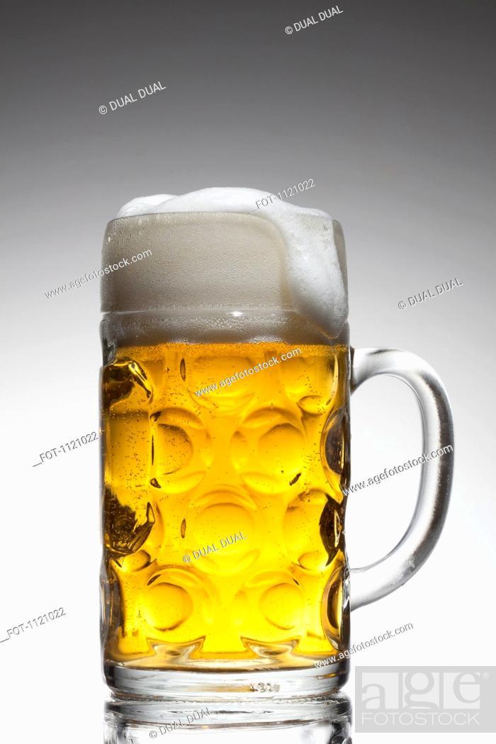 Stock Photo: A glass mug of beer.