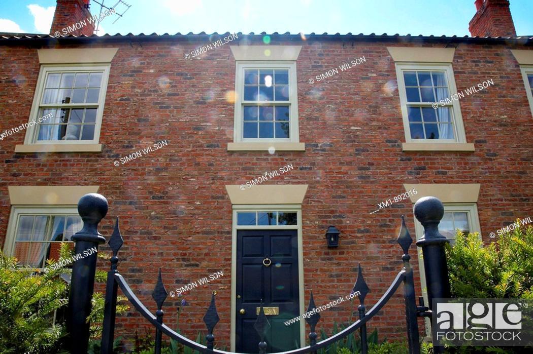 Stock Photo: Entrance to house through wrought iron gates.