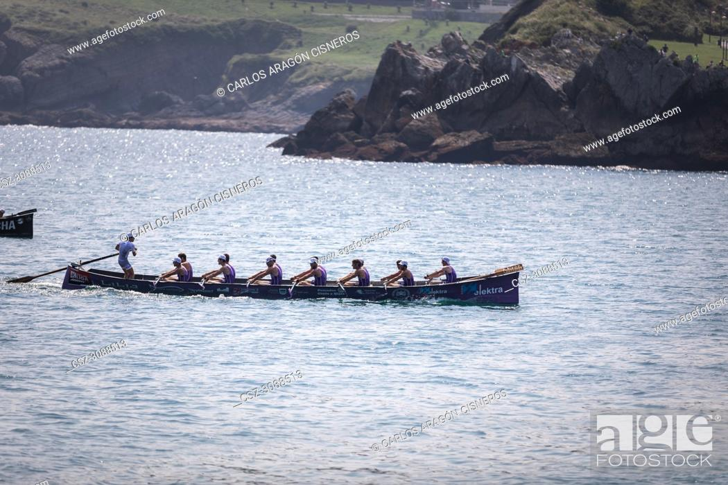 Stock Photo: CASTRO URDIALES, SPAIN - JULY 15, 2018: Competition of boats, regata of trainera, San Pedro boat in action in the VI Bandera CaixaBank competition.