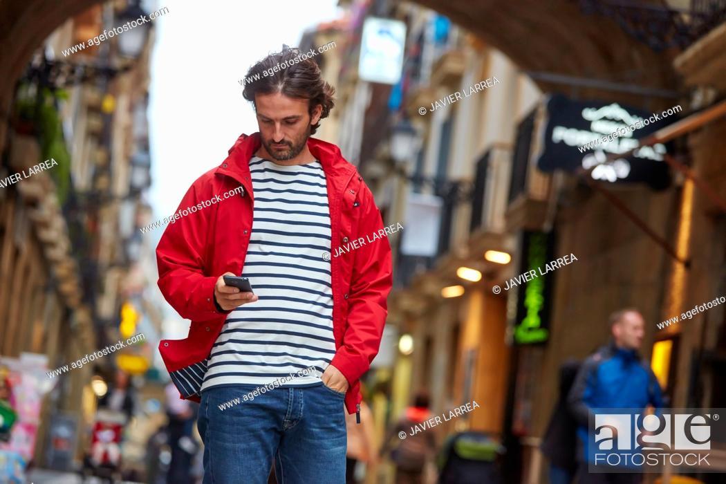 Photo de stock: Young man, Parte Vieja, Old town, Donostia, San Sebastian, Gipuzkoa, Basque Country, Spain, Europe.