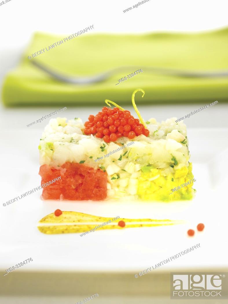 Stock Photo: corvina en tartar con tomate y huevas de salmon / sea ??bass in tartar with tomato and salmon roe.
