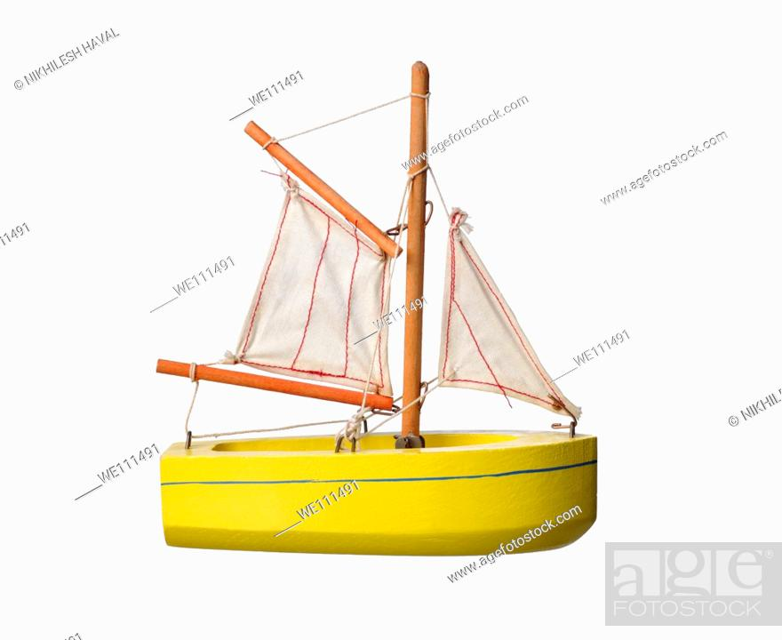 Stock Photo: Wooden toy sail boat.