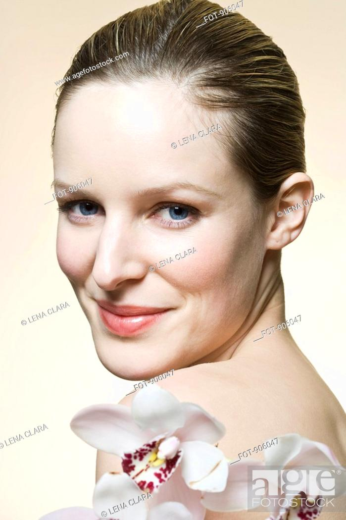 Stock Photo: A woman smiling at the camera, head and shoulders.