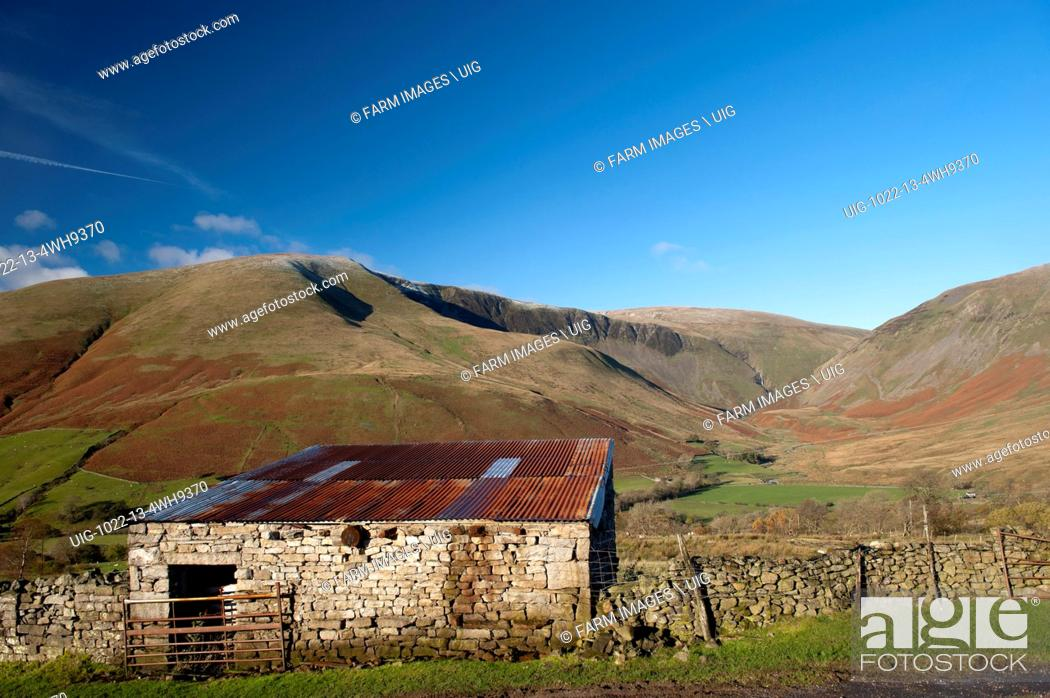 Stock Photo: Late autumn on Cautley Crag in the Howgills, seen from Bluecaster, Sedbergh, Cumbria, UK. (Photo by: Wayne Hutchinson/Farm Images/UIG).