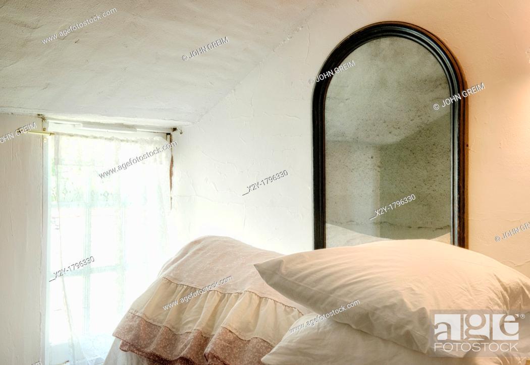 Stock Photo: Bedding, window, mirror.