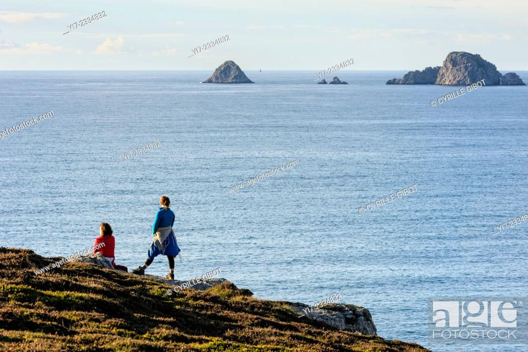Stock Photo: Two female hikers look out to sea, Crozon Peninsula, Finistere, Brittany, France.