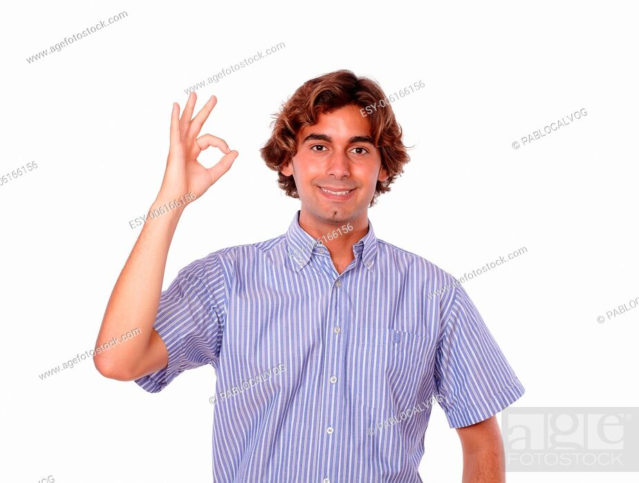 Stock Photo: Portrait of a handsome young man smiling and showing people ok sign while is standing over white background.