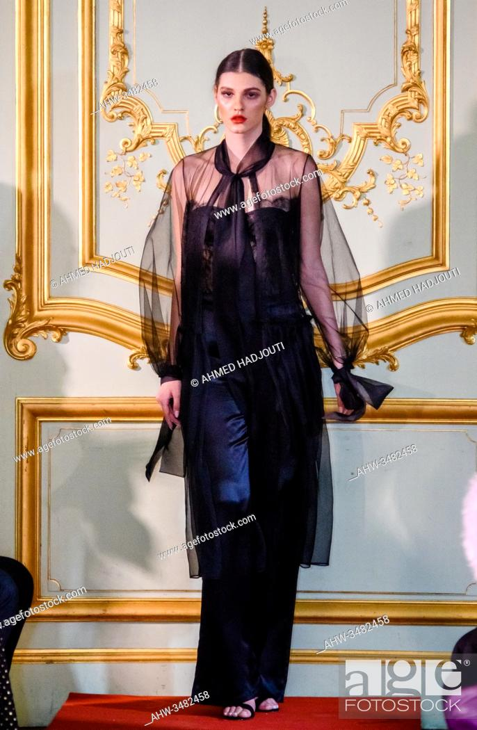 Stock Photo: PARIS, FRANCE - FEBRUARY 26: A model walks the runway during the Romanian designers collective show wearing the designs of Aureliana as part of Paris Fashion.