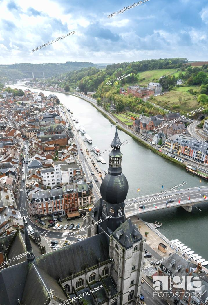 Stock Photo: Collegiate Church of Dinant towering above the River Meuse. Belguim. october 2019.