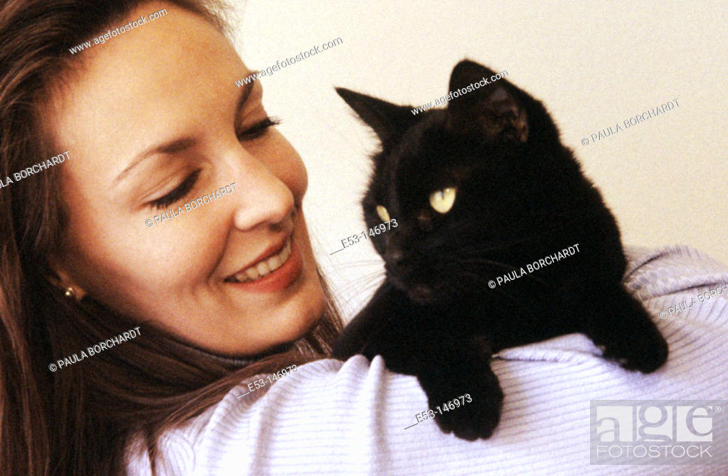 Stock Photo: Woman and cat.
