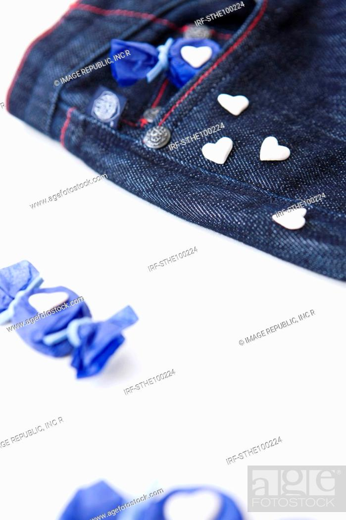 Stock Photo: candy and bule jeans.