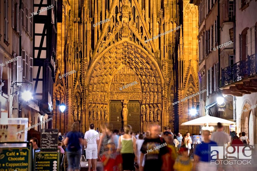 Stock Photo: People in an alley Rue Merciere, Strasbourg Cathedral in the background, Strasbourg, France.