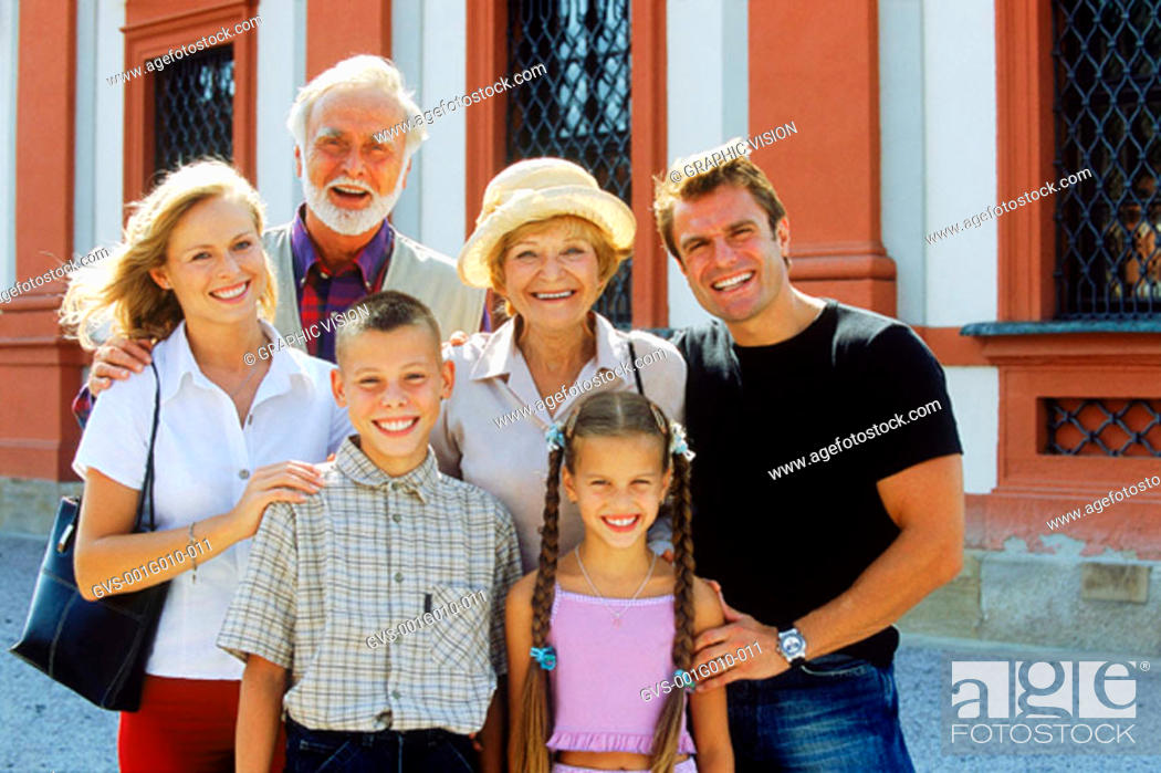 Stock Photo: Portrait of a family posing and smiling.