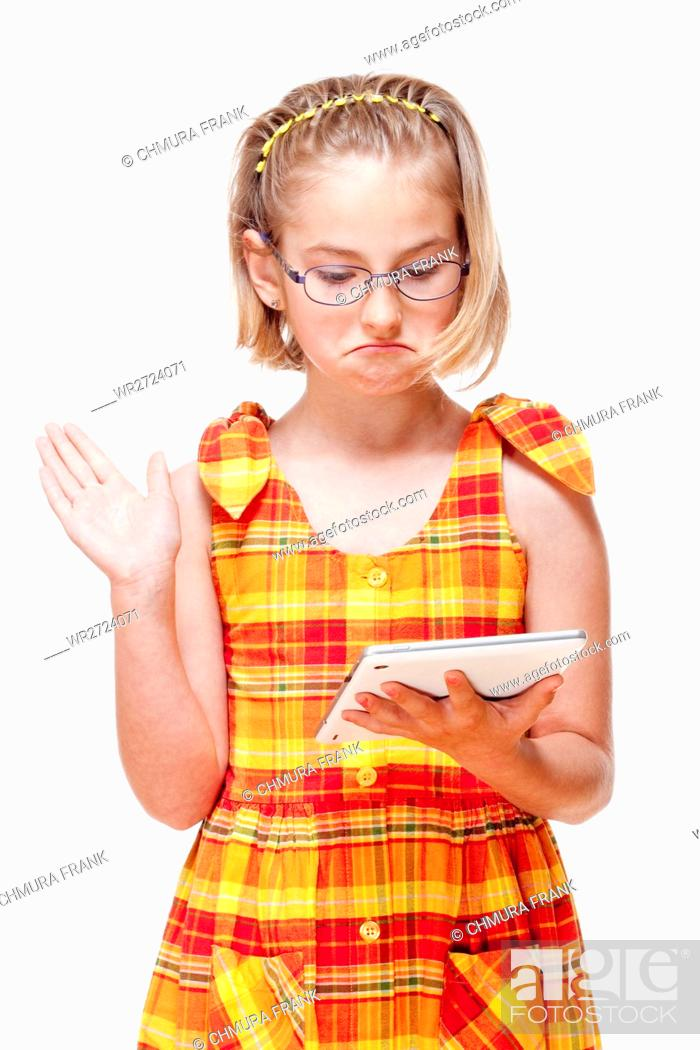 Stock Photo: Portrait of a Little Girl with Glasses Holding Tablet - Isolated on White.