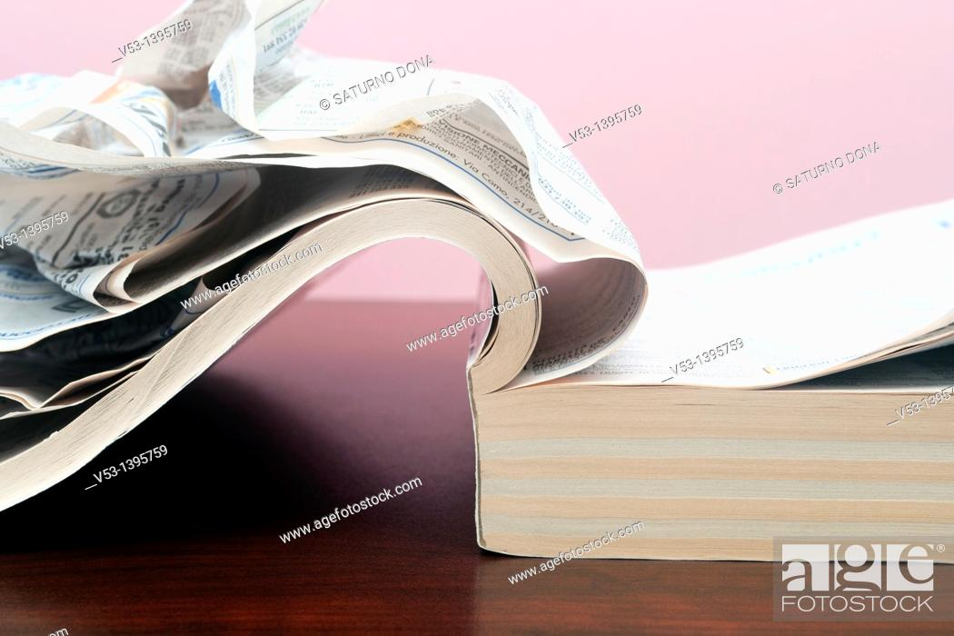 Stock Photo: telephone directory with crumpled pages.