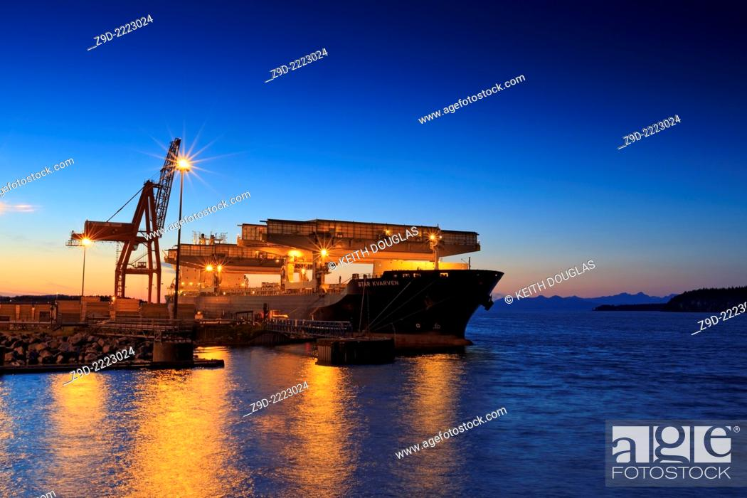 Stock Photo: Freighter being loaded with lumber, Duke Point wharf, Nanaimo, Vancouver Island, British Columbia.