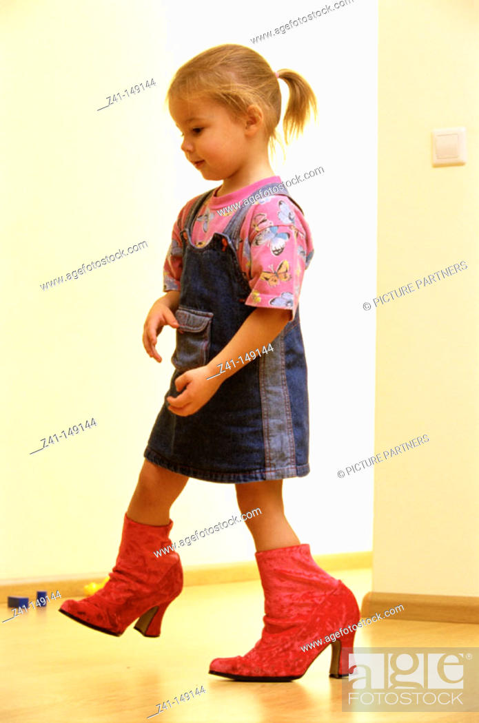 Stock Photo: Girl with big shoes.